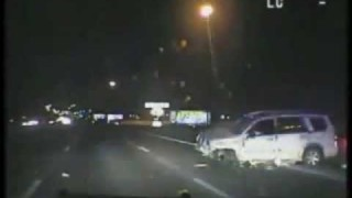 Police Dash Cam Catches SUV Rollover Accident