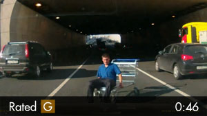Idiot in Shopping Cart on Highway