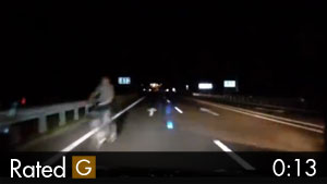 Guy Almost Hit Riding Bicycle Down Dark Highway
