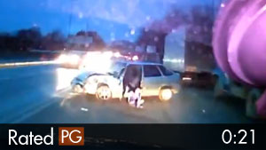 Woman Falls Out of Car Door in Accident, Barely Escapes Death