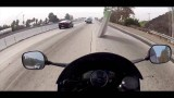 Motorcycle Almost Hits Flying Mattress on Highway